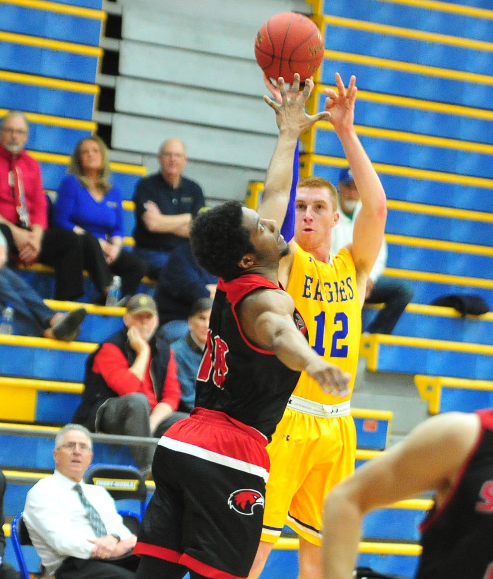 Embry Riddle's Nick Johnson sends up a three-pointer as the Eagles take on the Simpson University Redhawks Thursday, Jan. 31, 2019 in Prescott. (Les Stukenberg/Courier).