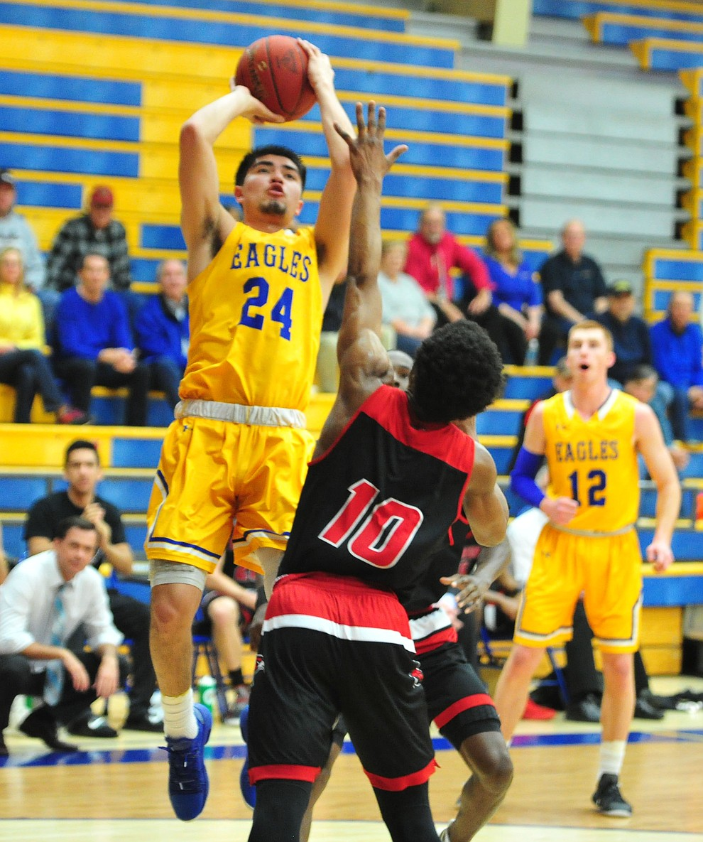 Embry Riddle's Gilbert Ibarra goes up for a shot late in the first half as the Eagles take on the Simpson University Redhawks Thursday, Jan. 31, 2019 in Prescott. (Les Stukenberg/Courier).