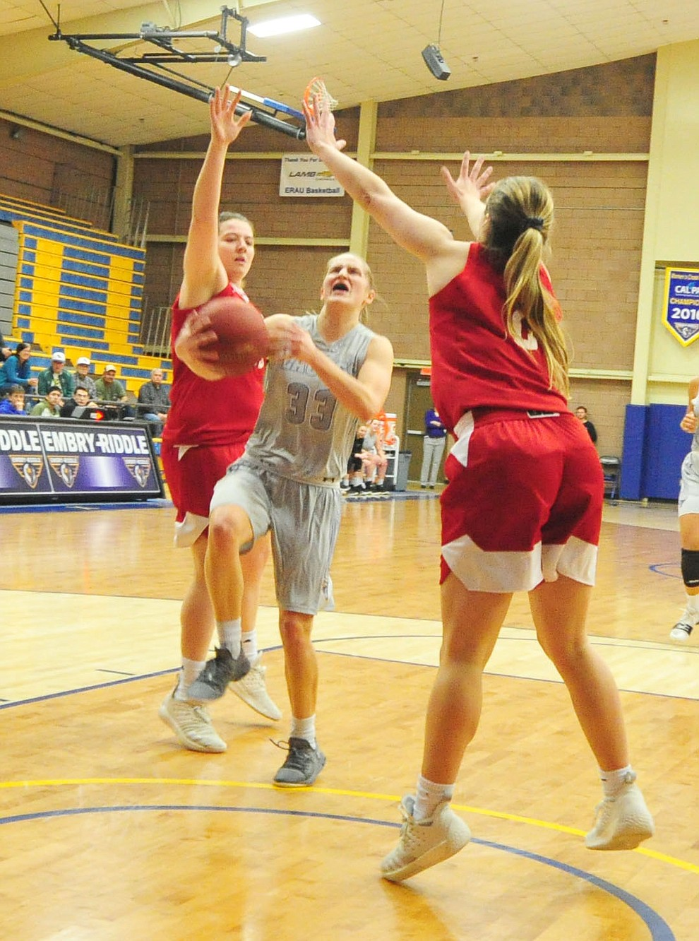 Embry Riddle's Jenna Knudson drives between a pair of defenders as the Eagles take on the Simpson University Redhawks Thursday, Jan. 31, 2019 in Prescott. (Les Stukenberg/Courier).