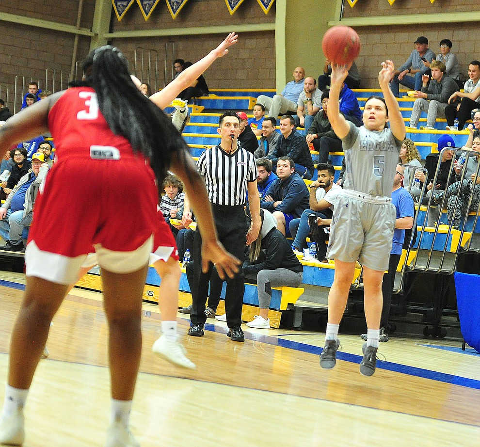 Embry Riddle's Bethany Wolph sinks a three-pointer as the Eagles take on the Simpson University Redhawks Thursday, Jan. 31, 2019 in Prescott. (Les Stukenberg/Courier).