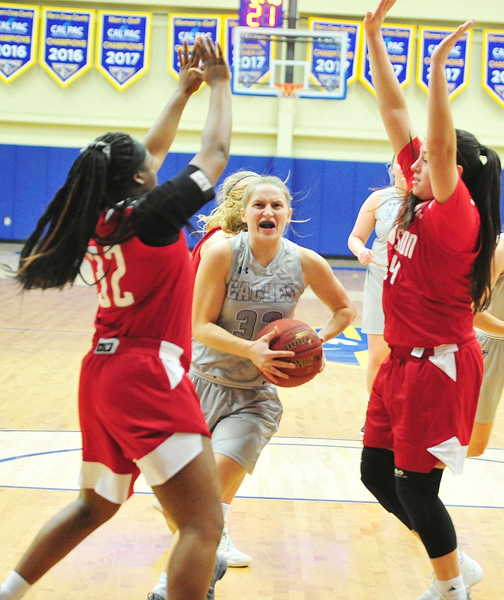 Embry Riddle's Jenna Knudson drives between defenders as the Eagles take on the Simpson University Redhawks Thursday, Jan. 31, 2019 in Prescott. (Les Stukenberg/Courier).