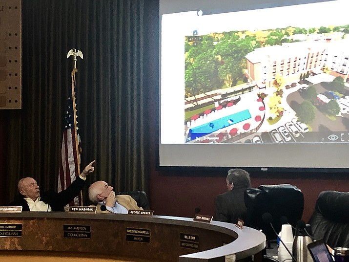 Prescott Planning and Zoning Commissioner Ted Gambogi, left, asks a question about the plans for the Hilton Garden Inn in downtown Prescott, while fellow Commissioner Ken Mabarak and Commission Chairman George Sheats look on. The commission kicked off a public review of the building details of the hotel project during its meeting on Thursday, Jan. 31, 2019. A vote on a proposed rezoning and site plan could take place at the next commission meeting on Feb. 14. (Cindy Barks/Courier)