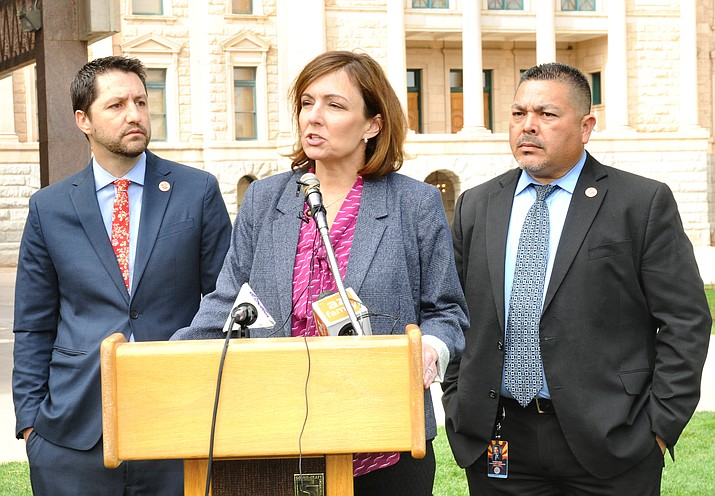 Joelle Casteix, a survivor of childhood sexual assault by a staffer at a Catholic school, explains Wednesday why she believes Arizona needs to give more time for victims to file civil suits. The bill is being pushed by Sens. Paul Boyer, left, and Lupe Contreras. (Capitol Media Services photo by Howard Fischer)
