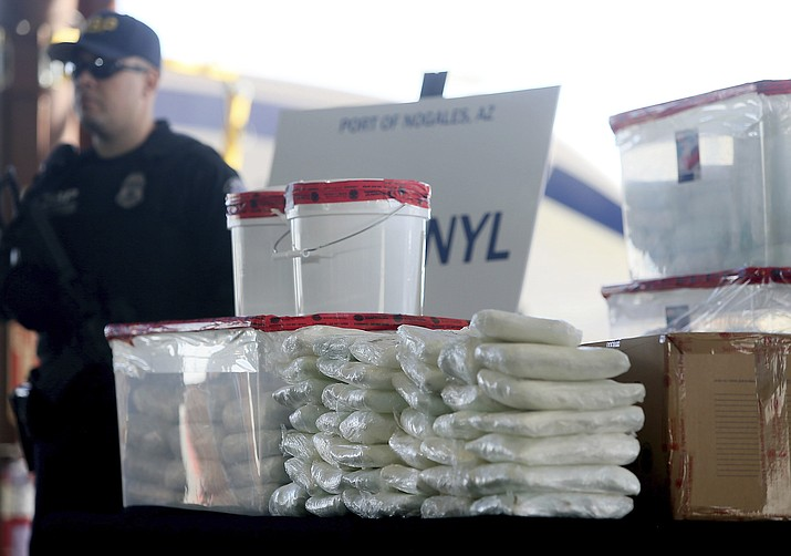 A display of the fentanyl and meth that was seized by Customs and Border Protection officers over the weekend at the Nogales Port of Entry is shown during a press conference Thursday, Jan. 31, 2019, in Nogales, Ariz. U.S. Customs and Border Protection officials announced Thursday their biggest fentanyl bust ever, saying they captured nearly 254 pounds (114 kilograms) of the deadly synthetic opioid from a secret compartment inside a load of Mexican produce heading into Arizona. (Mamta Popat/Arizona Daily Star via AP)