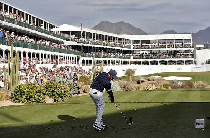 Harold Varner III hits from the 16th tee during the first round of the Phoenix Open PGA golf tournament, Thursday, Jan. 31, 2019, in Scottsdale, Ariz. (Matt York/AP)