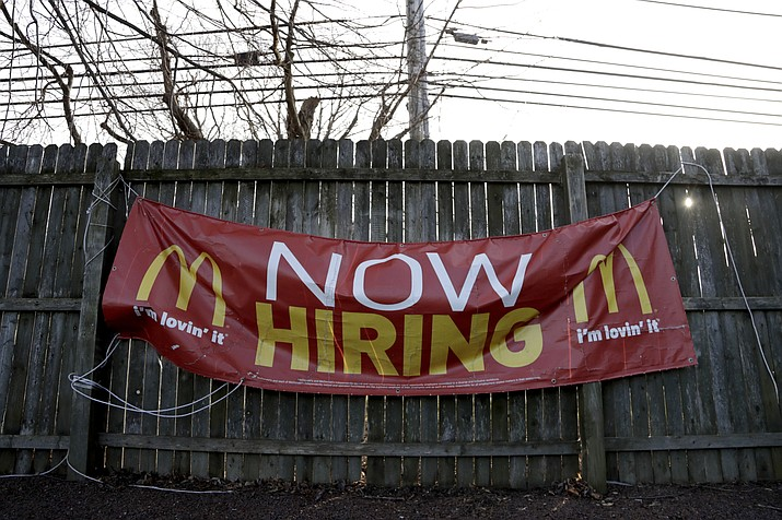 In this Jan. 3, 2019, file photo an employment sign hangs from a wooden fence on the property of a McDonald's restaurant in Atlantic Highlands, N.J. On Friday, Feb. 1, the U.S. government issues the January jobs report, which will reveal the latest unemployment rate and number of jobs U.S. employers added. (AP Photo/Julio Cortez, File)