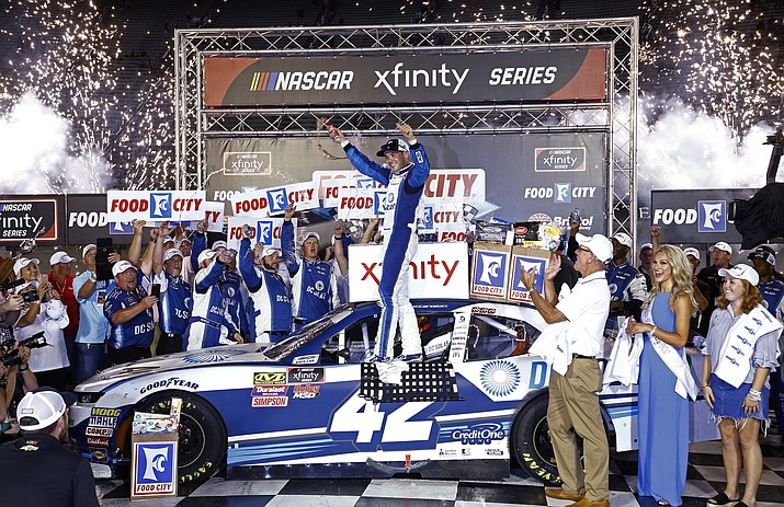 FILE- In this Aug. 17, 2018, file photo, Kyle Larson celebrates in Victory Lane after winning the NASCAR Xfinity Series auto race in Bristol, Tenn. As Larsen enters his sixth season at NASCAR's top level it is clear that once he starts winning on a consistent basis he could become the biggest star in the country.  (Wade Payne/AP, File)