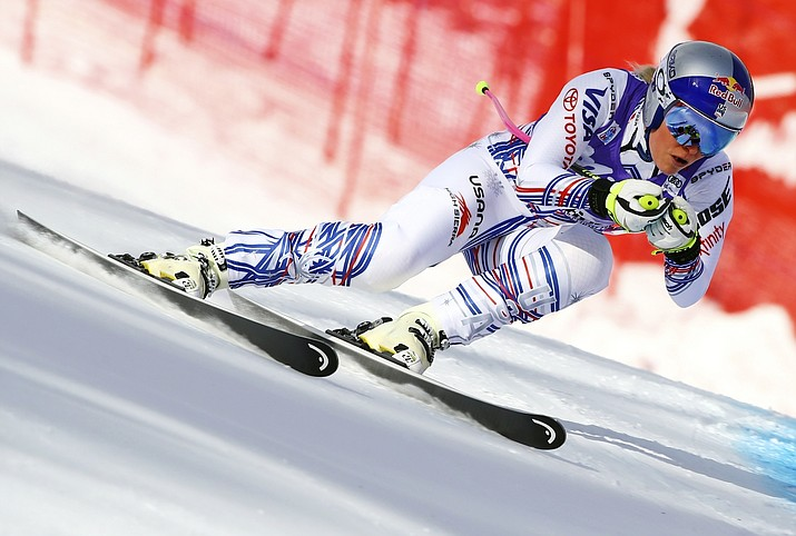 In this Saturday, Jan. 19, 2019, file photo, United States' Lindsey Vonn competes during the women's World Cup downhill ski race in Cortina D'Ampezzo, Italy. Vonn announced Friday, Feb. 1, 2019, that she will retire from ski racing after this month's world championships in Sweden. (Marco Trovati/AP, File)