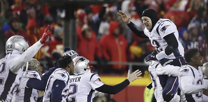 New England Patriots quarterback Tom Brady (12) celebrates with his teammates after the AFC Championship NFL football game, Sunday, Jan. 20, 2019, in Kansas City, Mo. (Charlie Neibergall/AP)