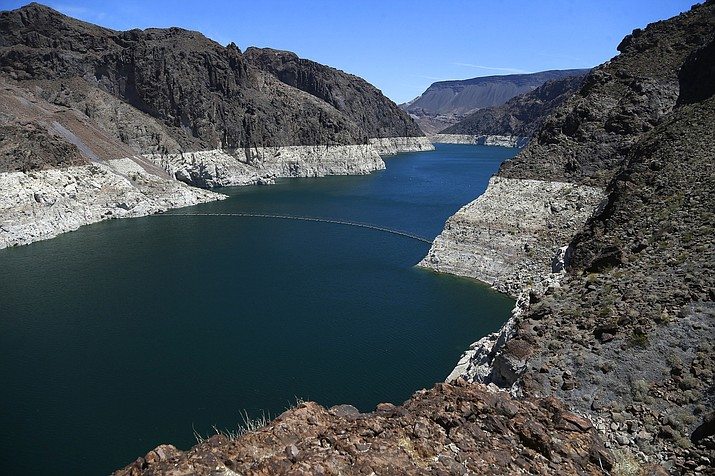 This May 31, 2018 file photo shows the reduced water level of Lake Mead behind Hoover Dam in Arizona. (Ross D. Franklin/AP, File)