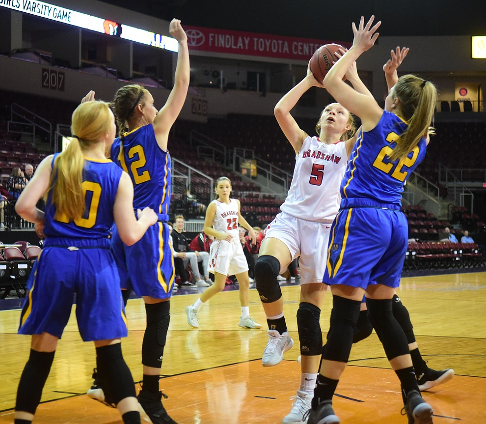 Bradshaw Mountain's Sierra Woolley gets a shot off between three defenders as the Bears play cross-town rival Prescott at the Findlay Toyota Center in Prescott Valley Saturday, Feb. 2, 2019. (Les Stukenberg/Courier).