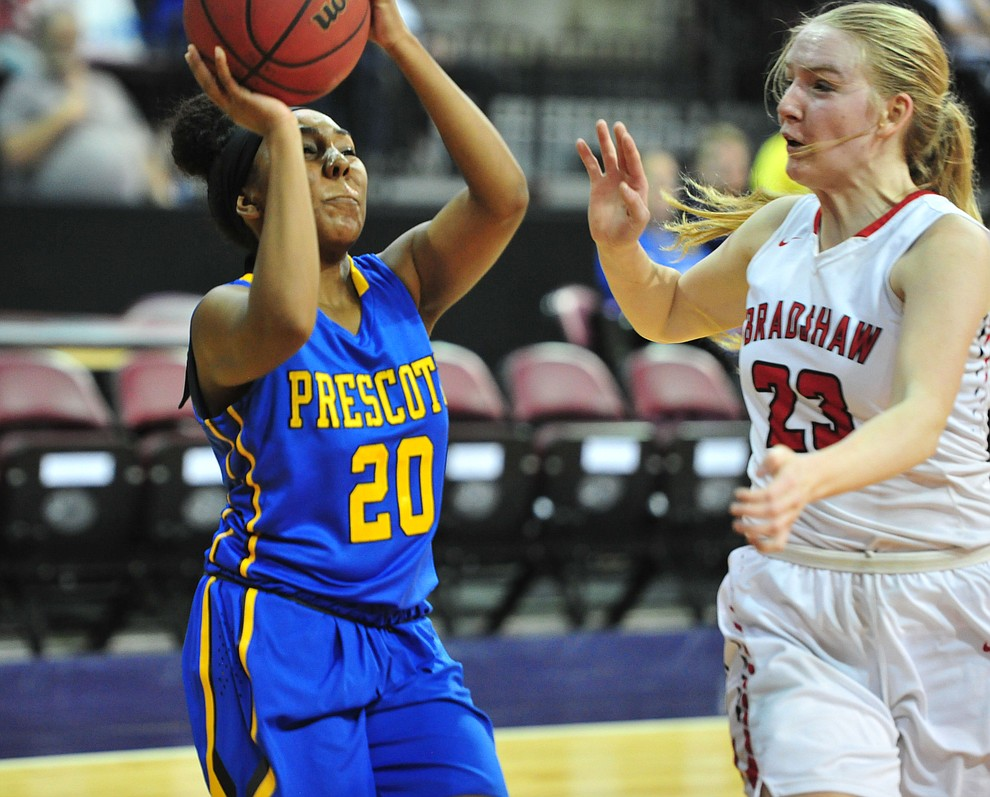 Prescott's Ebony Porter takes a shot as the Badgers play cross-town rival Bradshaw Mountain at the Findlay Toyota Center in Prescott Valley Saturday, Feb. 2, 2019. (Les Stukenberg/Courier).