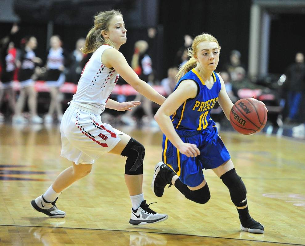 Prescott's Kendall Crockett drives the ball on Brinlee Kidd as the Badgers play cross-town rival Bradshaw Mountain at the Findlay Toyota Center in Prescott Valley Saturday, Feb. 2, 2019. (Les Stukenberg/Courier).