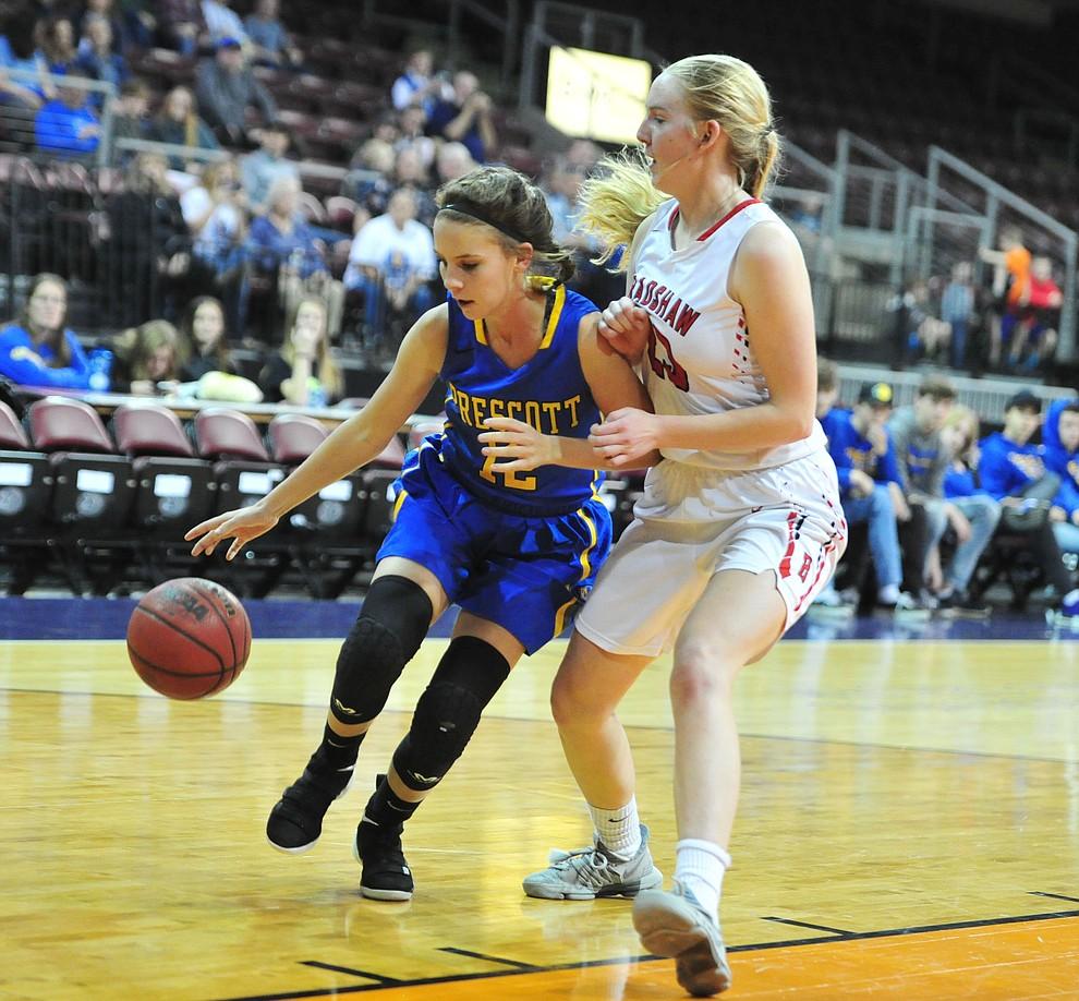 Prescott's Desiree Johnson drives to the lane on Rylee Bundrick as the Badgers play cross-town rival Bradshaw Mountain at the Findlay Toyota Center in Prescott Valley Saturday, Feb. 2, 2019. (Les Stukenberg/Courier).
