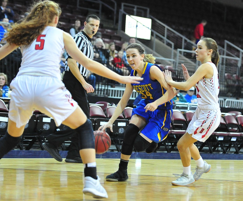 Prescott's Hollie Dalton drives between defenders as the Badgers play cross-town rival Bradshaw Mountain at the Findlay Toyota Center in Prescott Valley Saturday, Feb. 2, 2019. (Les Stukenberg/Courier).