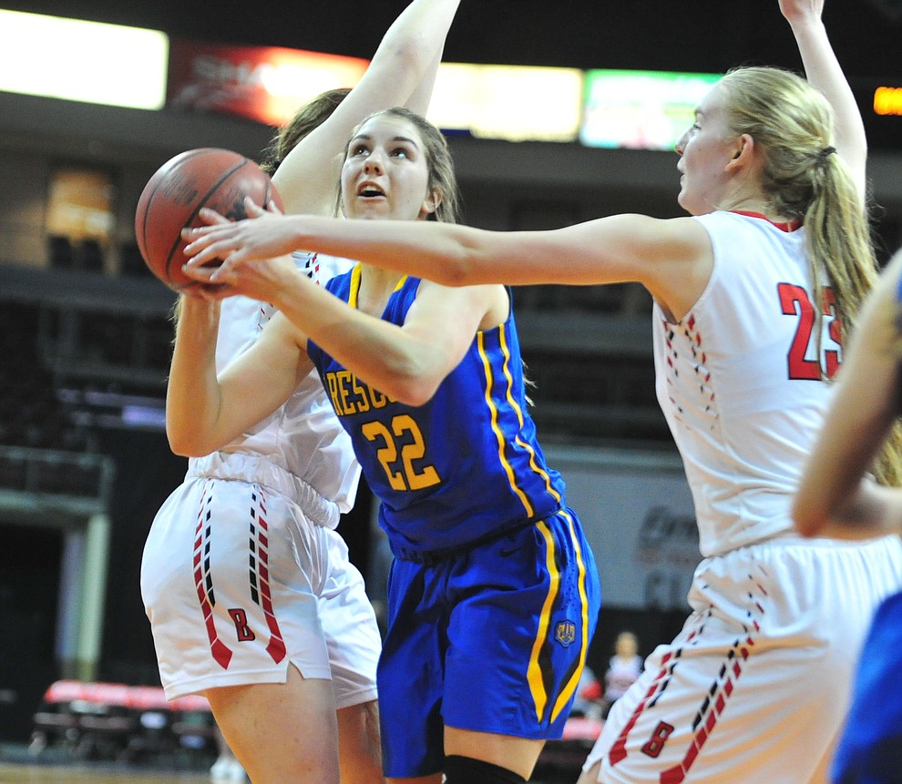 Prescott's Kira Reily drives between defenders as the Badgers play cross-town rival Bradshaw Mountain at the Findlay Toyota Center in Prescott Valley Saturday, Feb. 2, 2019. (Les Stukenberg/Courier).