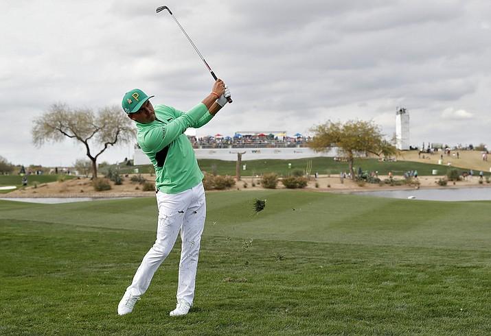 Rickie Fowler hits from the 15th fairway during the third round of the Phoenix Open PGA golf tournament, Saturday, Feb. 2, 2019, in Scottsdale, Ariz. (Matt York/AP)