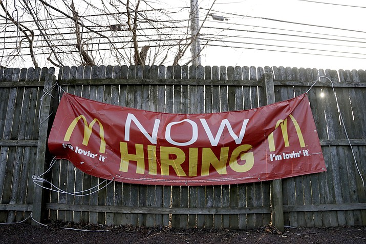 An employment sign hangs from a wooden fence on the property of a McDonald's restaurant. On Friday, Feb. 1, the U.S. government issued the January jobs report, which revealed the latest unemployment rate and number of jobs U.S. employers added. (Julio Cortez/AP, File)