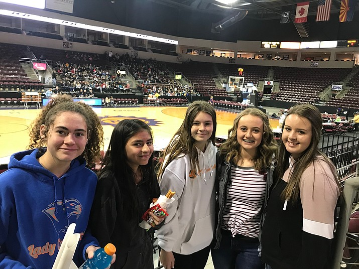 Liliana Hickenbottom, Lizbeth Sauzameda Mikaya Moody, Mikayla Brooks, Brianna James of Heritage Middle School pose for a photo at a Northern Arizona Suns game Jan. 22 in Prescott Valley. (HMS/Courtesy)