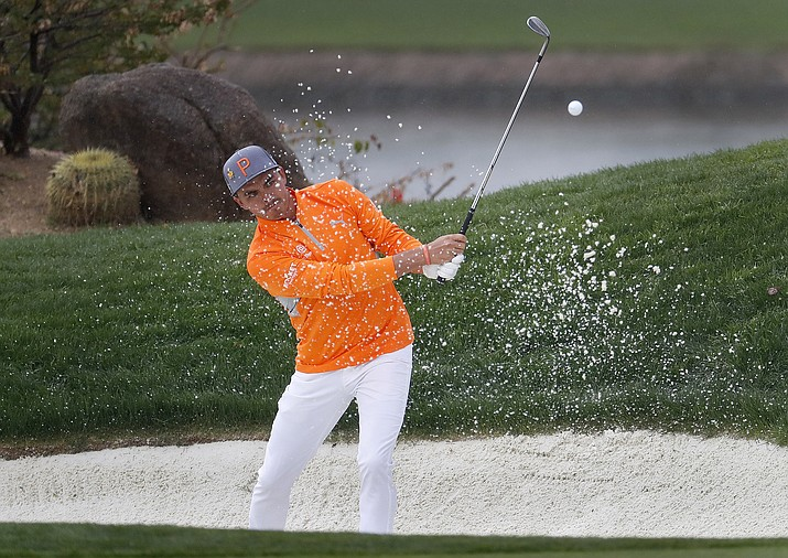 Rickie Fowler hits from the bunker on the 12th green during the final round of the Phoenix Open PGA golf tournament, Sunday, Feb. 3, 2019, in Scottsdale. (Matt York/AP)