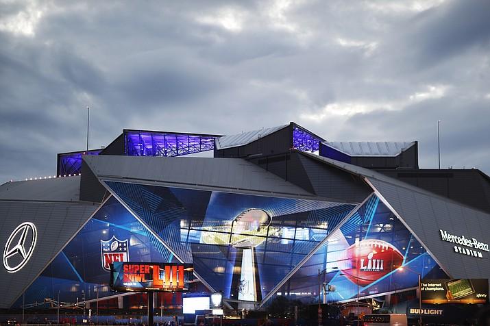 Mercedes-Benz Stadium is lit up ahead of Sunday's NFL Super Bowl 53 football game between the Los Angeles Rams and New England Patriots in Atlanta, Saturday, Feb. 2, 2019. (David Goldman/AP)