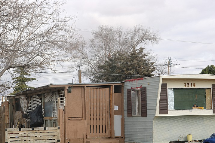 """The first parcel of land, located at 3215 E. Carver Ave. and owned by Elmer Wilde, was deemed to pose an """"immediate threat to the public health and safety"""" due to debris and trash, according to the meeting agenda. (Photo by Travis Rains/Daily Miner)"""