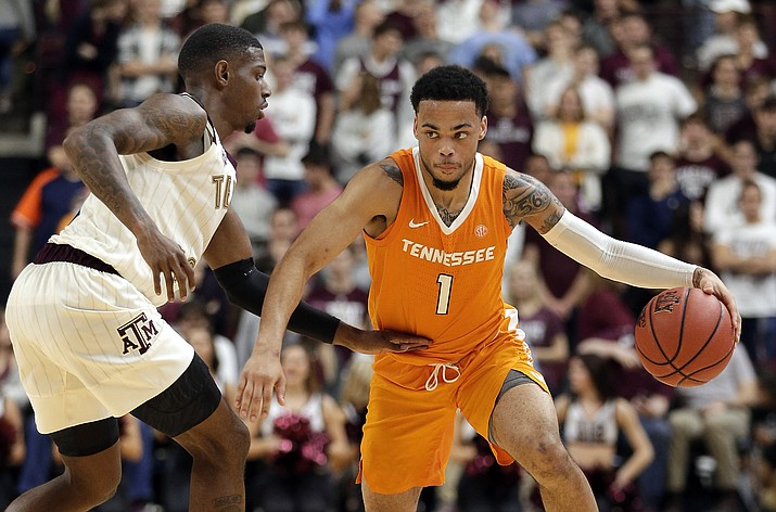 Tennessee guard Lamonte Turner (1) drives around Texas A&M guard Jay Jay Chandler, left, during the second half of an NCAA college basketball game Saturday, Feb. 2, 2019, in College Station, Texas. (Michael Wyke/AP)