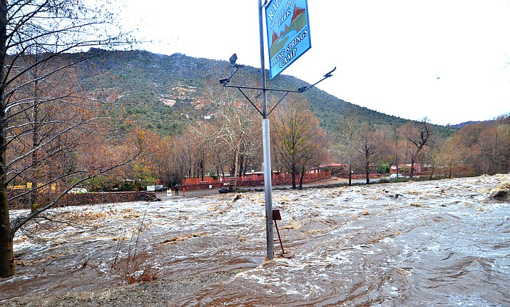 Flood waters at the low water crossing to Sedona's Rainbow Trout Farm in Oak Creek Sunday morning. VVN/Vyto Starinskas