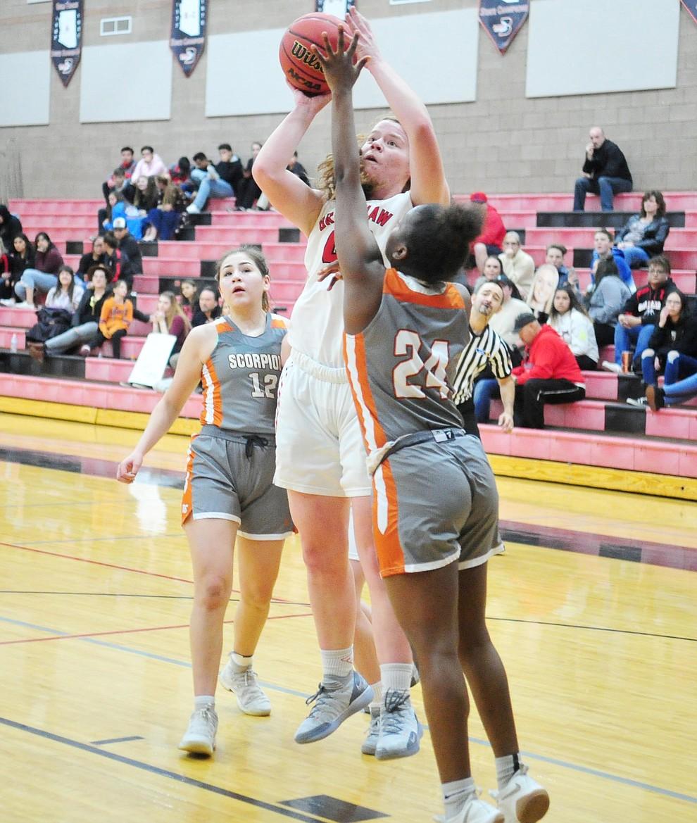 Bradshaw Mountain's Delanie Clark takes a contested shot as the Bears play Desert Edge in their regular season finale in Prescott Valley Tuesday, Feb. 5, 2019. (Les Stukenberg/Courier).