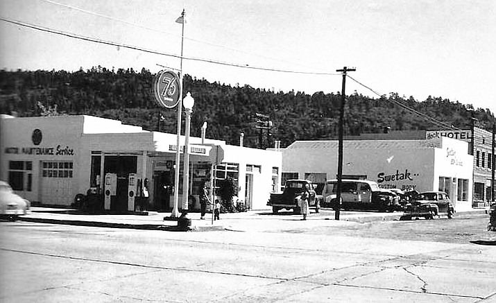 A 76 gas station, Swetak custom body shop and a hotel lined Third Street in Williams in 1950. (Massey collection/Williams Historic Photo Project)