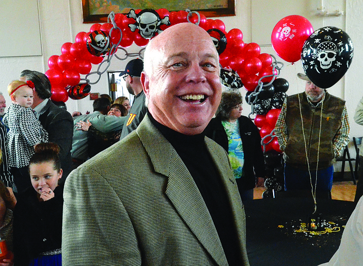 Doug Bartosh smiles as he attends his retirement party at the Cottonwood Community Clubhouse Saturday with family, friends and city staff. Bartosh was appointed as the Cottonwood city manager in January 2008. Cottonwood City Council unanimously approved a contract with Ron Corbin to replace the retiring Bartosh as city manager. Below left, he is introduced with his wife Diana, and, below right, a ship cake awaits the guests.VVN/Vyto Starinskas