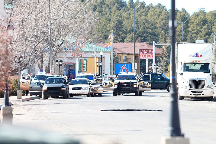 Law enforcement surround a suicidal suspect who barricaded himself in his vehicle Jan. 30 in Williams. (Loretta Yerian/WGCN)