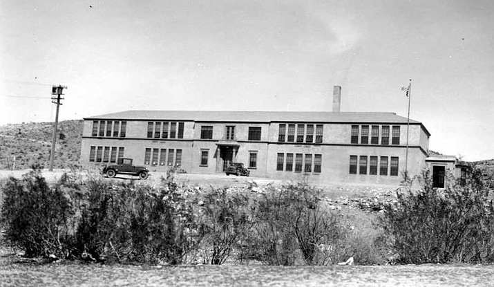 Two trucks can be seen in front of the nearly completed Kingman Grammar School around 1928. (Photo courtesy Mohave Museum of History and Arts)
