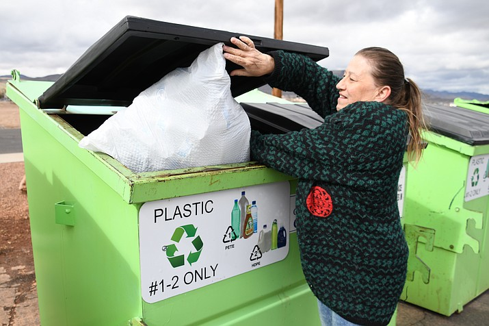 Della Kuntz was utilizing the recycling bins Tuesday afternoon at Centennial Park. (Photo by Vanessa Espinoza/Daily Miner)