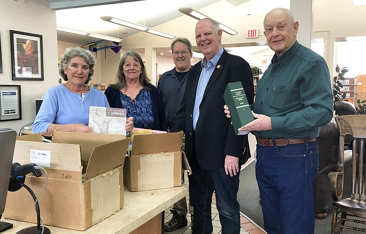"Andrea Dunn, Sherry Sleeper, Keith Brekhus and Al Richmond meet with Rep. Tom O""Halleran (center) Feb. 1 as he donates books to the Williams Public Library. (Wendy Howell/WGCN)"