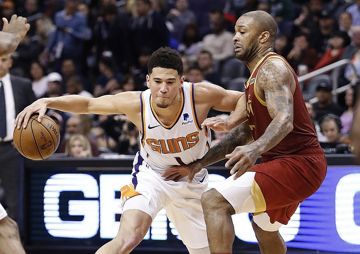 Phoenix Suns guard Devin Booker drives against the Houston Rockets forward PJ Tucker, right, during the second half of an NBA basketball game, Monday, Feb. 4, 2019, in Phoenix. (Matt York/AP)