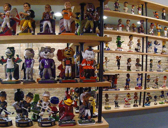 In this Jan. 8, 2019 photo bobbleheads are on display at the National Bobblehead Hall of Fame and Museum in Milwaukee. The new museum may well hold the largest collection of bobbleheads anyone has ever seen, displaying more than 6,500 figures of athletes, mascots, celebrities, animals, cartoon characters, politicians and more. (AP Photo/Carrie Antlfinger)