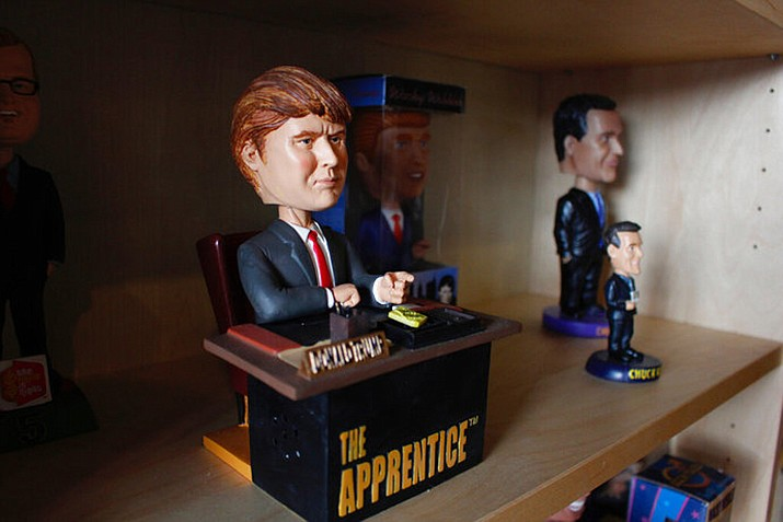 "In this Jan. 8, 2019 photo, a bobblehead depicting Donald Trump from the TV show ""The Apprentice,"" which says ""You're fired"" upon the press of a button is on display at the National Bobblehead Hall of Fame and Museum in Milwaukee. The new museum will be displaying more than 6,500 figures of athletes, mascots, celebrities, animals, cartoon characters, politicians and more. (AP Photo/Carrie Antlfinger)"