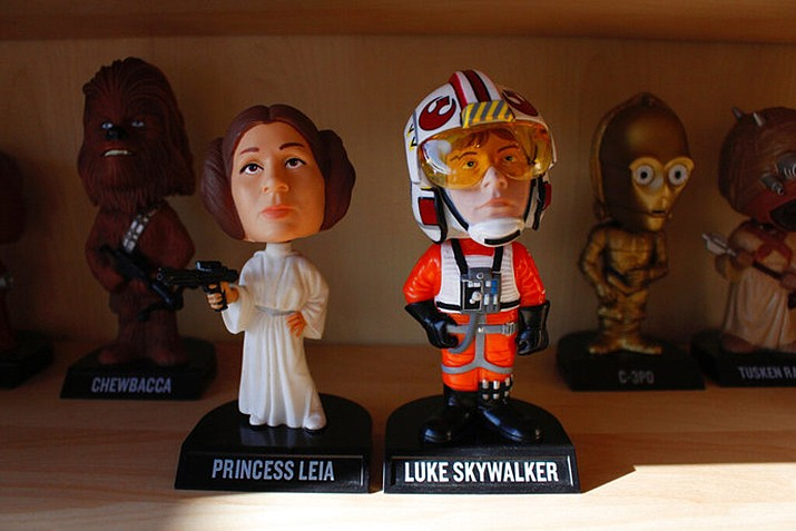 "In this Jan. 8, 2019 photo, bobbleheads from the ""Star Wars"" movies are displayed at National Bobblehead Hall of Fame and Museum in Milwaukee. The new museum will have on view more than 6,500 figures of athletes, mascots, celebrities, animals, cartoon characters, politicians and more. (AP Photo/Carrie Antlfinger)"