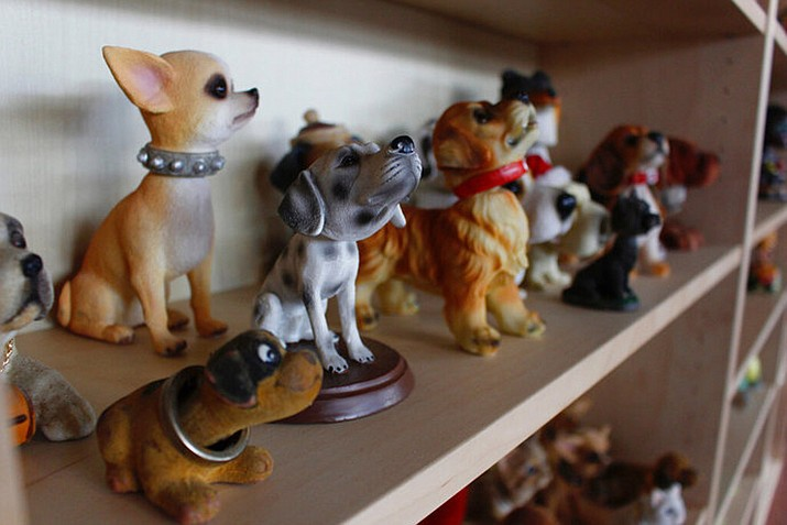 In this Jan. 8, 2019 photo, dog bobbleheads are displayed at the National Bobblehead Hall of Fame and Museum in Milwaukee. The new museum is displaying more than 6,500 figures of athletes, mascots, celebrities, animals, cartoon characters, politicians and more. (AP Photo/Carrie Antlfinger)
