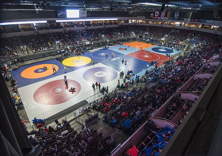 Hundreds of wrestlers along with their families and friends descend on the Findlay Toyota Center in 2017. The 2019 state wrestling tournament in Prescott Valley on Thursday through Saturday, Feb. 7 to 9, features grapplers from all classifications. (Les Stukenberg/Courier, file)