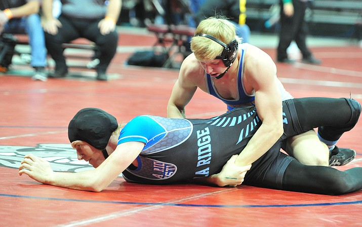 Chino Valley's Keller Rock defeats Gila Ridge's Justin Rhodes by pin during the first round of the Arizona Interscholastic Association Division 3 State Wrestling Tournament Thursday, Feb. 7, 2019 at the Findlay Toyota Center in Prescott Valley. (Les Stukenberg/Courier)