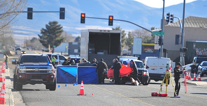 Prescott Valley Police work the scene of a fatal vehicle versus pedestrian collision near the intersection of Spouse Drive and Robert Road, Thursday, Feb. 7, 2019. (Les Stukenberg/Courier)