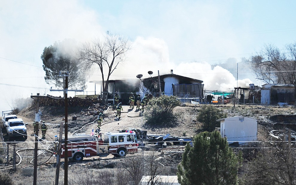 Central Arizona and Prescott fire personnel fight a structure fire in the 12400 block of Pinto Place in Dewey-Humboldt Thursday, Feb. 7, 2019 . (Les Stukenberg/Courier).