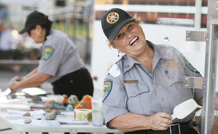Volunteers with the Camp Verde Marshal's Office's Volunteers in Policing program – known as VIPs – help with the annual National Night Out event. VVN/Bill Helm