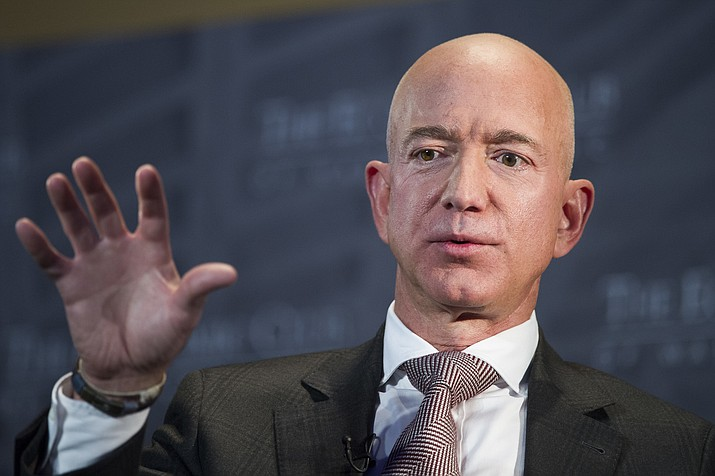 In this Sept. 13, 2018, file photo Jeff Bezos, Amazon founder and CEO, speaks at The Economic Club of Washington's Milestone Celebration in Washington. Bezos says the National Enquirer is threatening to publish nude photographs of him unless his private investigators back off the tabloid that detailed the billionaire's extramarital affair (AP Photo/Cliff Owen, File)