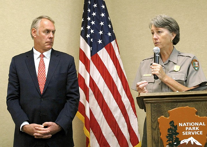 In this Oct. 13, 2017, file photo, then-Interior Secretary Ryan Zinke, left, and Grand Canyon National Park Superintendent Christine Lehnertz address National Park Service employees at Grand Canyon National Park, Ariz. Lehnertz is returning to work after being cleared in a federal investigation. (AP Photo/Felicia Fonseca, File)