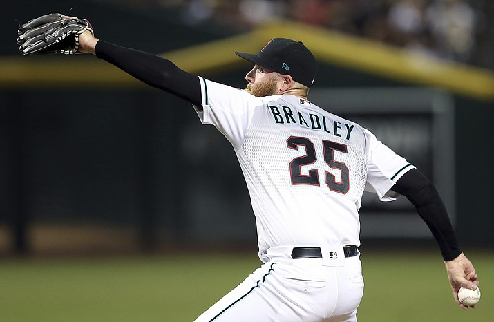 In this Sept. 7, 2018, file photo, Arizona Diamondbacks relief pitcher Archie Bradley throws to an Atlanta Braves batter during the eighth inning of a baseball game in Phoenix. The closer role is open, but Bradley is the early leader for that role. (Ralph Freso/AP, file)