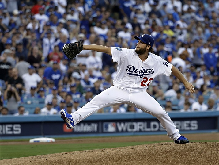 In this Oct. 28, 2018, file photo, Los Angeles Dodgers pitcher Clayton Kershaw winds up during the first inning in Game 5 of the World Series baseball game against the Boston Red Sox, in Los Angeles. Kershaw, one of the game's elite pitchers, anchors a deep rotation that is key to the Dodgers' continued success. (David J. Phillip/AP, file)