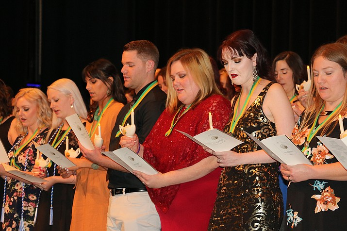 Prescott area and Verde Valley graduates of the YC Nursing Program recite the Florence Nightingale Pledge during a traditional pinning ceremony on Dec. 14 at the YC Performing Arts Center. (Courtesy)